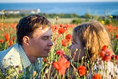 beautiful couple young women and young man in flowers Stock Image