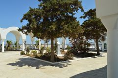 Beautiful Courtyard Of The Church Of Fira On The Island Of Santorini. Travel, Cruises, Architecture, Landscapes. July 7, 2018. Fira, Santorini Island, Greece royalty free stock photography