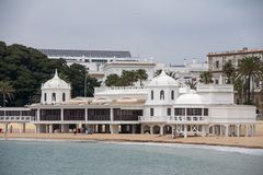Beautiful beach of the city of Cadiz, Andalusia. Beautiful cove beach with the spa in the background stock photography