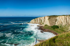 Beautiful cove with cliff in a sunny day Stock Photos