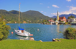 Beautiful cove of lake tegernsee with sailboat and Rottach-Egern Stock Image