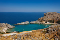Beautiful cove at Saint Paul`s Bay, Lindos, Greece Royalty Free Stock Images