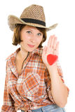 Beautiful cowboy woman holding a red heart Stock Image