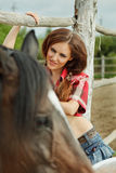 Beautiful cowgirl. Shot in the stable Royalty Free Stock Image