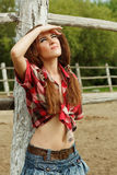 Beautiful cowgirl. Shot in the stable Royalty Free Stock Images