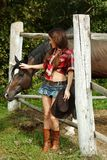 Beautiful cowgirl. Shot in the stable Stock Photography
