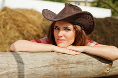 Beautiful cowgirl. Shot in the stable Stock Photo
