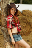Beautiful cowgirl. Shot in the stable Royalty Free Stock Photo