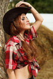 Beautiful cowgirl. Shot in the stable Royalty Free Stock Photos
