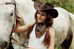 Beautiful cowgirl. Shot in the stable Stock Images