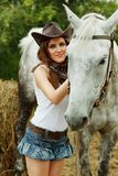Beautiful cowgirl. Shot in the stable Royalty Free Stock Photography