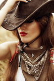 Beautiful cowgirl. Shot in the stable Stock Image