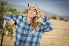 Beautiful Cowgirl Against Wire Fence in Field Royalty Free Stock Photo