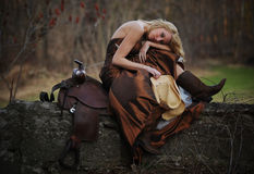 Beautiful cowgirl with blonde hair Royalty Free Stock Photos
