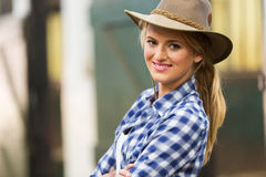 Beautiful cowgirl. Close up portrait in stables Stock Photo