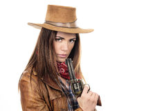 Beautiful cowgirl with gun Stock Images