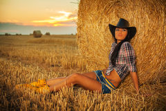 Beautiful Cowgirl in hay Royalty Free Stock Images