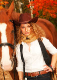 Beautiful cowgirl with her red horse. soft focus Royalty Free Stock Photo