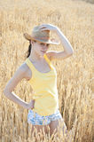 Beautiful cowgirl posing on field Stock Photo