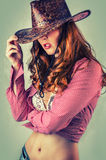 Beautiful cowgirl style woman with cowboy hat Royalty Free Stock Photography
