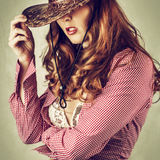 Beautiful cowgirl style woman wearing cowboy hat Royalty Free Stock Photography
