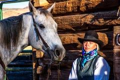 Beautiful Cowgirl in Western Scene Stock Photo