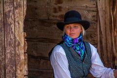 Beautiful Cowgirl in Western Scene Stock Photography