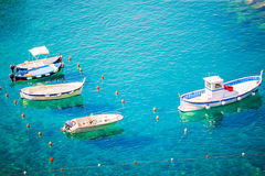 Beautiful cozy bay with boats and clear turquoise water in Italy, Europe Royalty Free Stock Image