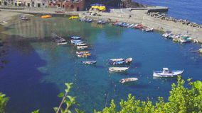 Beautiful cozy bay with boats and clear turquoise water in Italy, Europe stock video footage