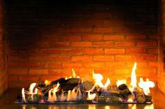 Beautiful cozy fireplace. Lit by the fire Royalty Free Stock Image