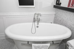 Beautiful cozy inviting  view of luxury vintage retro style bathtub and beautiful stylish faucet Royalty Free Stock Photography