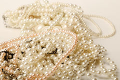 Beautiful cream pearl necklaces on a white background Stock Photo