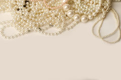 Beautiful cream pearl necklaces on a white background Stock Image