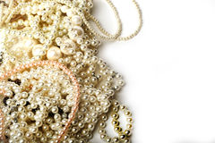 Beautiful cream pearl necklaces on a white background Royalty Free Stock Image