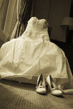 Beautiful cream wedding dress and shoes Royalty Free Stock Images