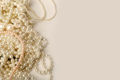 Beautiful cream wedding pearl necklaces on a grey background. An assortment of beautiful cream pearl necklaces on a grey background Stock Photography