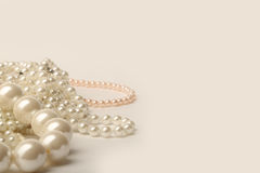 Beautiful cream wedding pearl necklaces on a white background Royalty Free Stock Photo