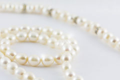 Beautiful creamy pearls necklace curve isolated on white backgro Royalty Free Stock Image