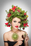 Beautiful creative Xmas makeup and hair style indoor shoot. Beauty Fashion Model Girl. Winter. Beautiful fashionable in studio. Attractive girl with Christmas Royalty Free Stock Photography