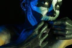 Beautiful creepy girl with skeleton makeup stock photo