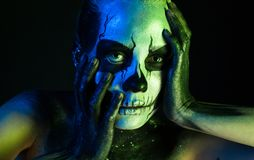 Beautiful creepy girl with skeleton makeup royalty free stock images