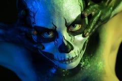 Beautiful creepy girl with skeleton makeup stock image