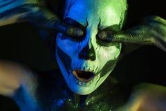 Beautiful creepy girl with skeleton makeup royalty free stock photos