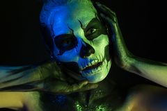 Beautiful creepy girl with skeleton makeup stock photography