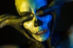 Beautiful creepy girl with skeleton makeup stock images