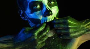 Beautiful creepy girl with skeleton makeup royalty free stock photo