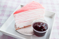 Beautiful crepe cake with blueberry sauce Royalty Free Stock Photos