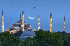 Beautiful crescent moon over Blue Mosque in Istanbul, Turkey. Beautiful crescent moon setting over Blue Mosque in Istanbul, Turkey royalty free stock image