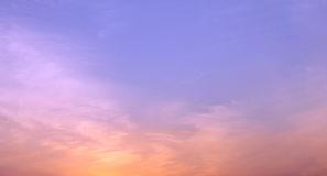 Beautiful crimson sky in evening after sunset during dusk in cloudless weather. In summer Stock Photos