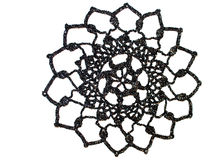 Beautiful crochet doily. A beautiful silver-black crochet doily against white Royalty Free Stock Image